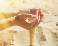 sand-pours-fingers-young-girl-beach-hot-summer-day-left-falling-sunlight-selective-focus-image-67237537
